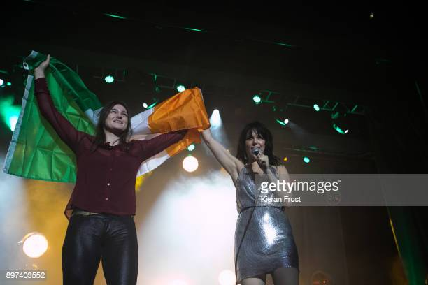 Katie Taylor appears onstage with Imelda May at 3Arena Dublin on December 22, 2017 in Dublin, Ireland.