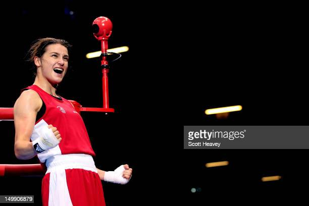 Katie Taylor of Ireland celebrates after defeating Natasha Jonas of Great Britain in the Women's Light Boxing Quarterfinals on Day 10 of the London...