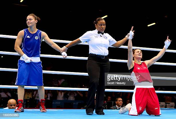 Katie Taylor of Ireland celebrates winning her bout against Sofya Ochigava of Russia during the Women's Fly Boxing final bout on Day 13 of the London...