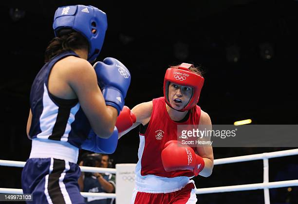 Katie Taylor of Ireland in action against Mavzuna Chorieva of Tajikistan during the Women's Light Boxing semifinals on Day 12 of the London 2012...