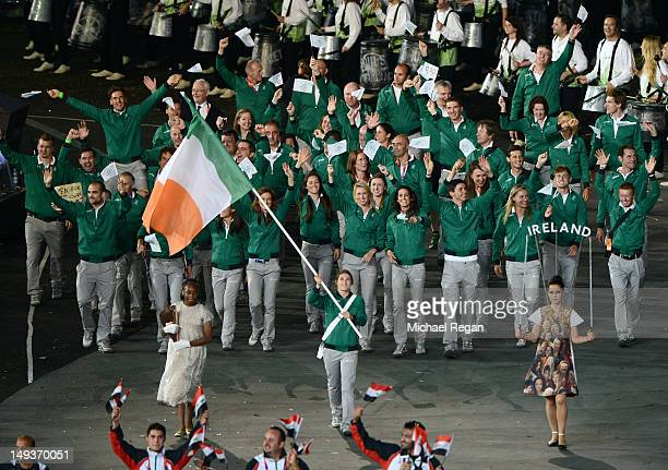 Katie Taylor of the Ireland Olympic boxing team carries her country's flag during the Opening Ceremony of the London 2012 Olympic Games at the...