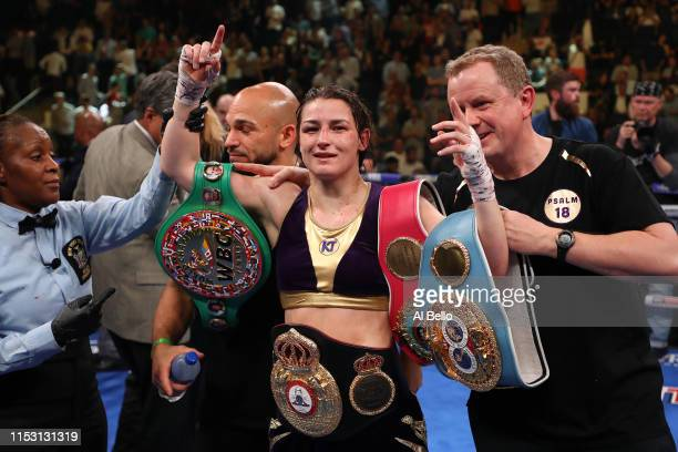 Katie Taylor reacts after a majority decision win against Delfine Persoon during their WBA/WBO/IBF/WBC women's lightweight unification fight at...