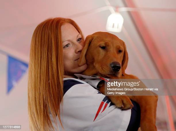 Katie Tierney and Bridger, a 5-month old Fox Red Lab, participate in the owner and dog look alike contest at Dogtoberfest at Harpoon on October 6,...