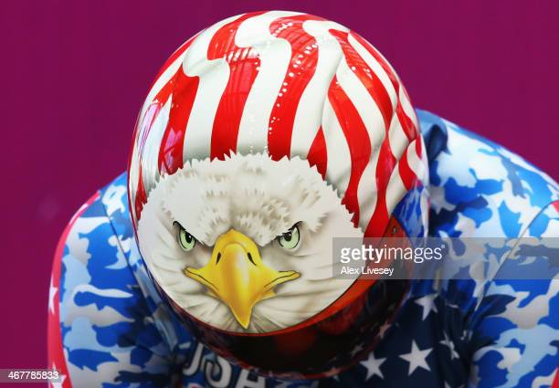 Katie Uhlaender of the United States shows a bald eagle design on her helmet as she prepares to make a run during a Women's Skeleton training session...