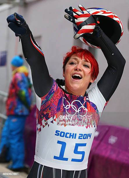 Katie Uhlaender of the United States waves to fans after comepting a run during the Women's Skeleton on Day 7 of the Sochi 2014 Winter Olympics at...