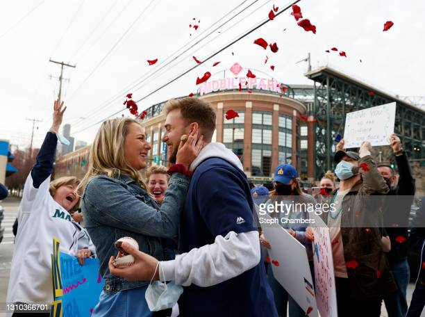 Katie Walsh and Brandon Kebba react after their wedding proposal on Opening Day before the game between the Seattle Mariners and the San Francisco...