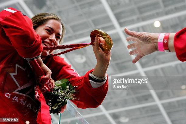 Katie Weatherston of Canada shows off her gold medal after their 4-1 victory over Sweden to win the gold medal in women's ice hockey during Day 10 of...