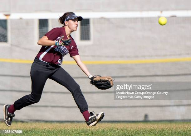Katie Williams of Laguna Beach attempts to catch a fly ball but misses during a game against Bolsa Grande at Thurston Middle School in Laguna Beach...