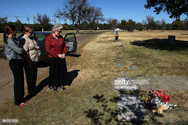 Katie Wood Suzanne Wood and Estelle Keys pay their respects to Buddy Holly at the City of Lubbock Cemetery on November 8 2008 in Lubbock Texas...