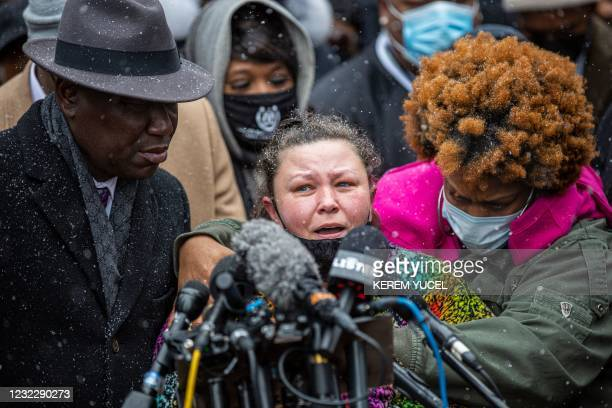 Katie Wright, mother of Daunte Wright , with Floyd family lawyer, Attorney Ben Crump , and Wright family members speaks during press conference at...