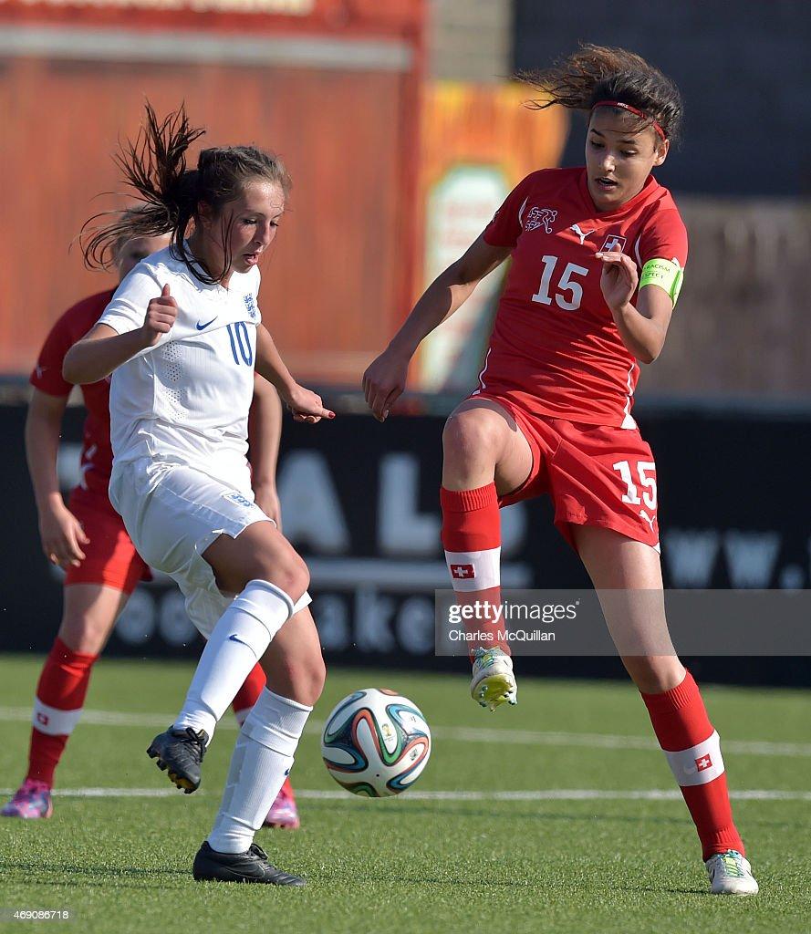 Katie Zelem (L) of England and Cinzia Zehnder (R) of Switzerland during the UEFA U19 Women's Qualifier between England and Switzerland at Seaview on April 9, 2015 in Belfast, Northern Ireland.