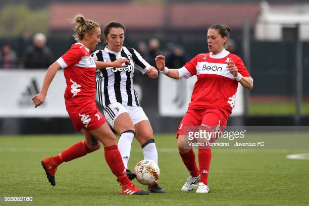 Katie Zelem of Juventus Women is challenged during the serie A match between Juventus Women and Pink Bari at Juventus Center Vinovo on March 17 2018...