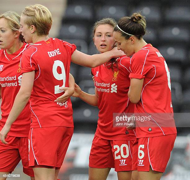 Katie Zelem of Liverpool is congratulated after scoring the winning goal at Select Security Stadium on August 24, 2014 in Widnes, England.