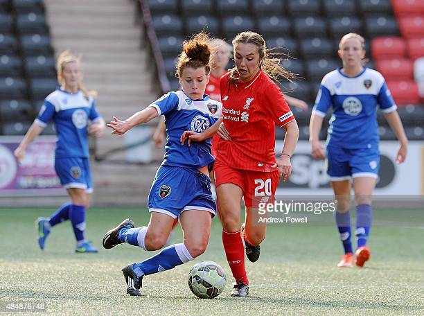 Katie Zelem of Liverpool Ladies competes with Angharad James of Bristol Academy Women during the Womens Super League match between Liverpool Ladies...