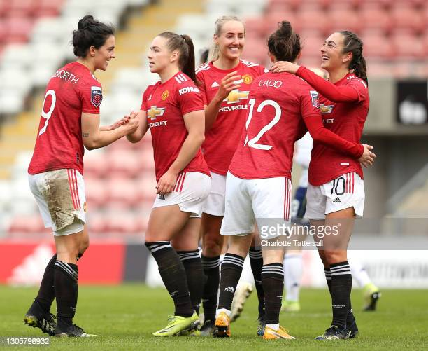 Katie Zelem of Manchester United celebrates with team mates after scoring their side's third goal during the Barclays FA Women's Super League match...