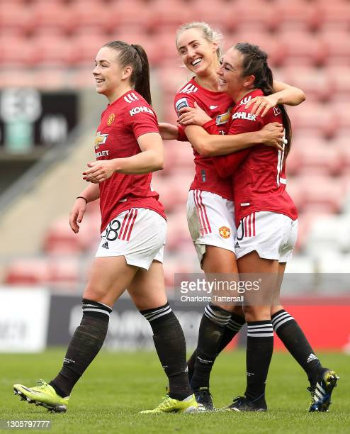 Katie Zelem of Manchester United celebrates with team mates Kirsty Hanson and Millie Turner after scoring their side's third goal during the Barclays...