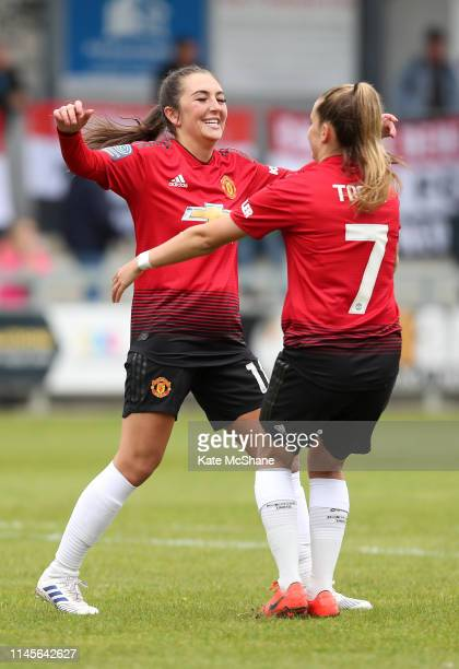 Katie Zelem of Manchester United Women celebrates scoring her side's first goal with team mate Ella Toone during the FA Women's Championship match...