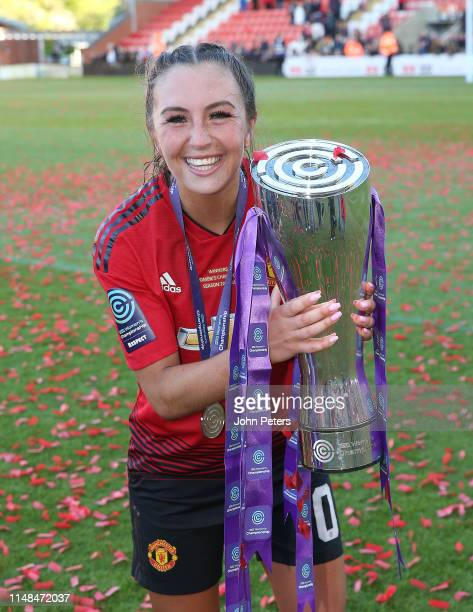 Katie Zelem of Manchester United Women poses with the FA Women's Championship trophy after the WSL match between Manchester United Women and Lewes...