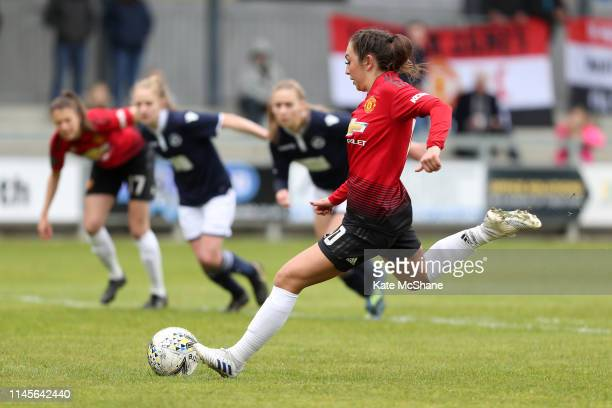 Katie Zelem of Manchester United Women shoots and scores a penalty her team's first goal during the FA Women's Championship match between Millwall...