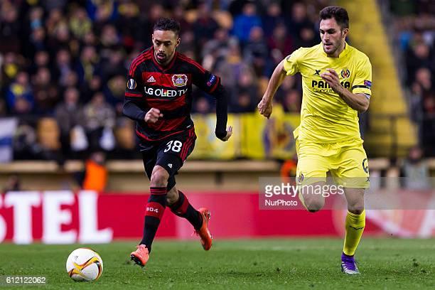 Katim Bellarabi of Bayer 04 Leverkusen and 06 Victor Ruiz del Villarreal CF during UEFA Europa League Round of 16 first legs match between Villarreal...