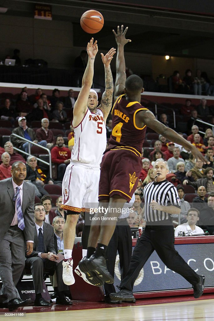 Katin Reinhardt #5 of the USC Trojans shoots a three-point shot over Gerrt Blakes #4 of the Arizona State Sundevils during a NCAA Pac12 college basketball game at Galen Center on January 7, 2016 in Los Angeles, California.