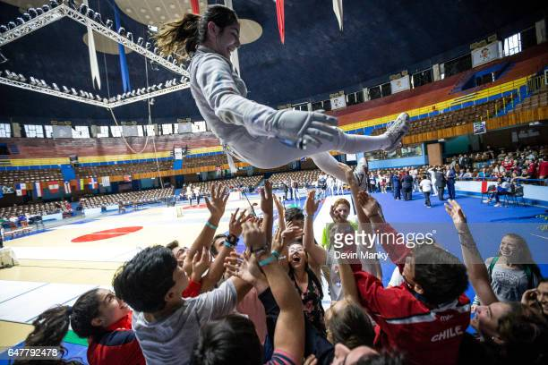 Katina Proestakis of Chile is hoisted into the air by teammates after winning the gold medal match of the Cadet Women's Foil competition at the Cadet...