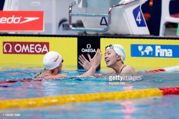 Katinka Hosszu of Hungary and Yui Ohashi of Japan shake hands after winning the gold and silver medals respectively after competing in the Women's...