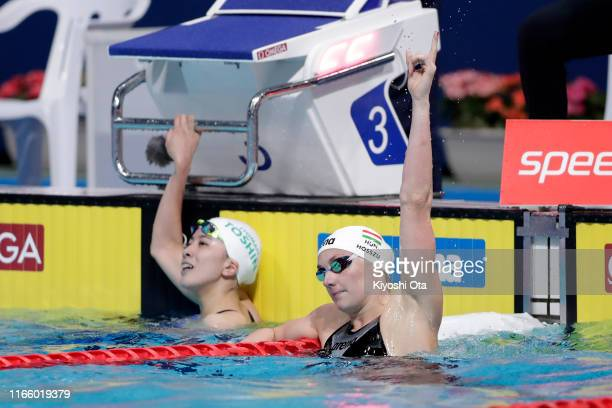 Katinka Hosszu of Hungary celebrates winning the gold while silver medalist Yui Ohashi of Japan shows dejection after competing in the Women's 200m...