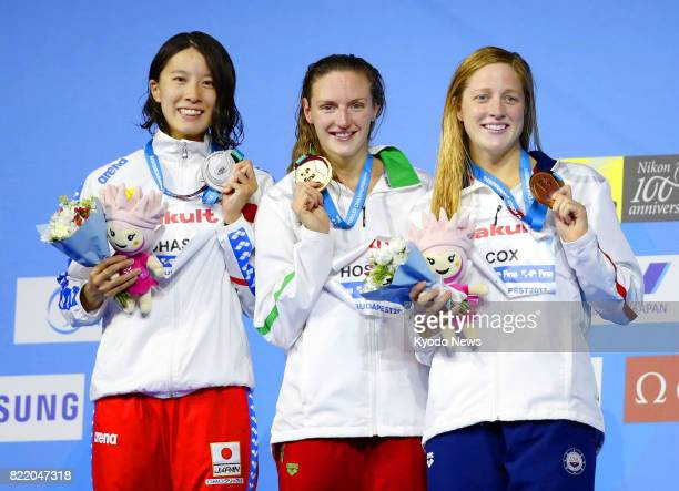 Katinka Hosszu of Hungary holds her gold medal for a photo along with silver medalist Yui Ohashi of Japan and bronze medalist Madisyn Cox of the...