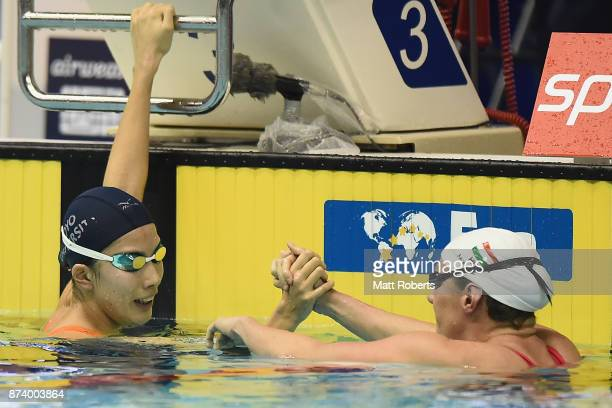 Katinka Hosszu of Hungary is congratulated by Yui Ohhashi of Japan after the Women's 400m Individual Medley final during day one of the FINA Swimming...