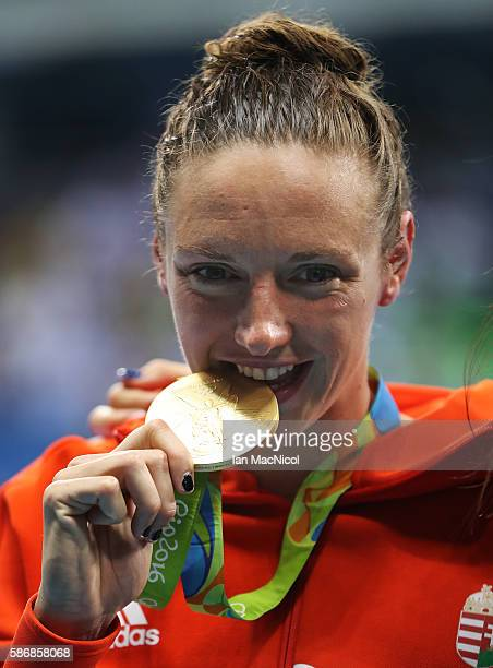 Katinka Hosszu of Hungary poses with her Gold medal after winning the Women's 400m IM on Day 1 of the Rio 2016 Olympic Games at the Olympic Aquatics...