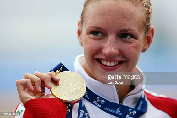 Katinka Hosszu of Hungary receives the gold medal during the medal ceremony for the Women's 400m Individual Medley Final during the 13th FINA World...