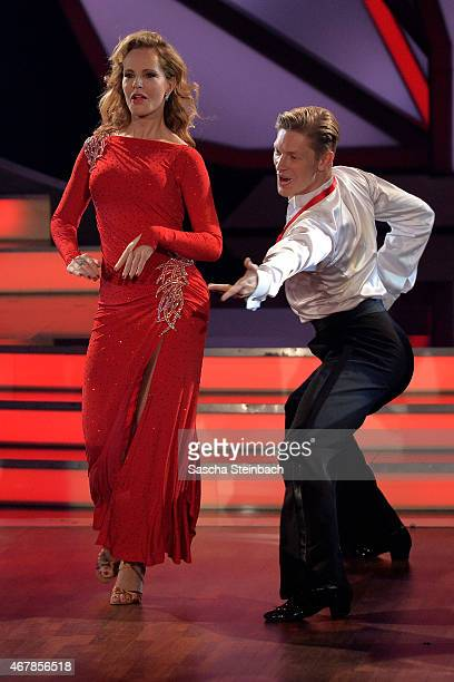 Katja Burkhard and Paul Lorenz perform on stage during the 3rd show of the television competition 'Let's Dance' on March 27 2015 in Cologne Germany