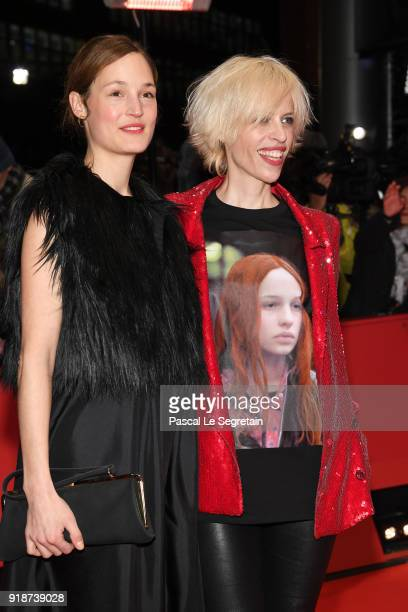 Katja Eichinger and a guest attend the Opening Ceremony 'Isle of Dogs' premiere during the 68th Berlinale International Film Festival Berlin at...