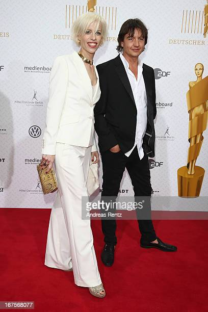 Katja Eichinger and Anthony James arrive for the Lola German Film Award 2013 at FriedrichstadtPalast on April 26 2013 in Berlin Germany