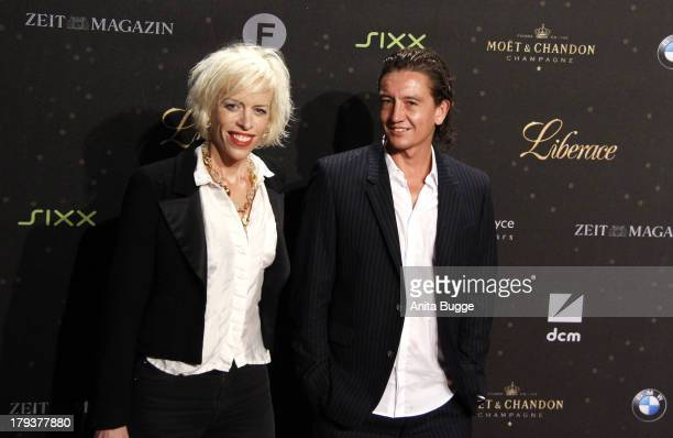Katja Eichinger and Anthony James attend the 'Liberace' Germany premiere at Admiralspalast on September 2 2013 in Berlin Germany