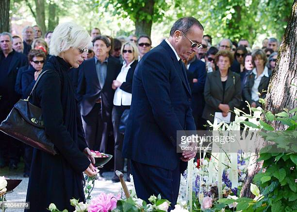 Katja Eichinger and Bernd Eichinger attend the funeral of German actress Barbara Rudnik at Nordfriedhof cemetery on May 29 2009 in Munich Germany