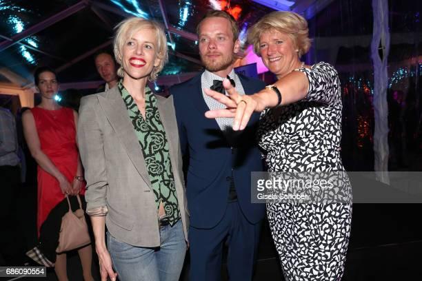 Katja Hofmann Stefan Konarske and Monika Gruetters attend the German Reception during the 70th annual Cannes Film Festival at Villa Rothschild on May...