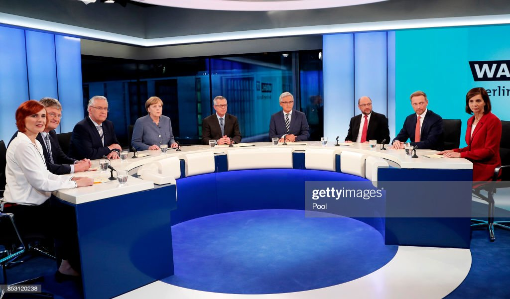 Katja Kipping, co-chairwoman of the German 'The Left' (Die Linke) party, Joerg Meuthen, federal co-chairman of the German 'Alternative for Germany' (AfD) party, Joachim Herrmann, Bavarian Minister of the Interior, German Chancellor Angela Merkel of the Christian Democratic Union (CDU), Martin Schulz (3-R), leader of the Social Democratic Party (SPD), Christian Lindner (2-R), chairman of the German Free Democratic Party (FDP), Katrin Goering-Eckardt (R), co-chairwoman of The Greens (Buendnis 90/Die Gruenen) party attend a TV discussion with the top candidates in the German federal elections on September 24, 2017 in Berlin, Germany. According to the federal election commissioner more than 61 million people were eligible to vote in the elections.
