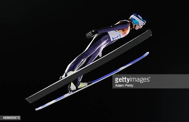 Katja Pozun of Slovenia jumps during the Ladies' Normal Hill Individual trial on day 4 of the Sochi 2014 Winter Olympics at the RusSki Gorki Ski...