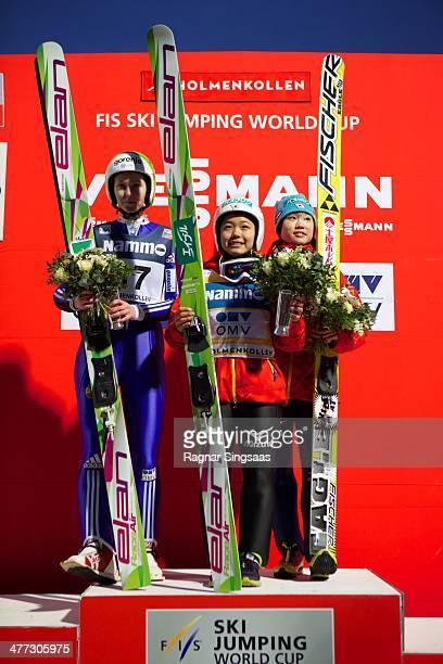 Katja Pozun of Slovenia takes second place Sara Takanashi of Japan takes first place and Yuki Ito of Japan takes third place during the FIS Ski...