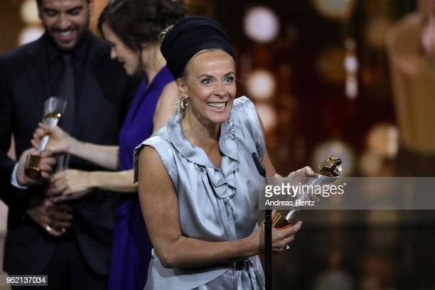 Katja Riemann accepts the award 'Biggest Movie Audience' for the film 'Fack ju Goehte' on stage during the Lola German Film Award show at Messe...
