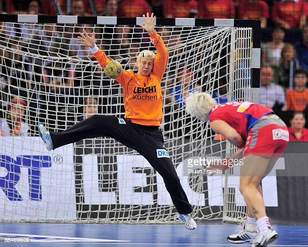 Katja Schuelke of Germany saves a shot by Tatjana Medved of Serbia during the Women's Handball World Championship qualification game between Germany...