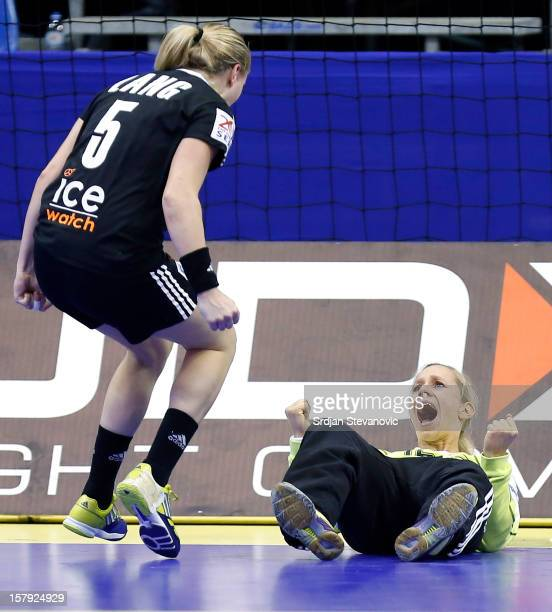 Katja Schulke and Saskia Lang of Germany celebrate during the Women's European Handball Championship 2012 Group C match between Croatia and Germany...