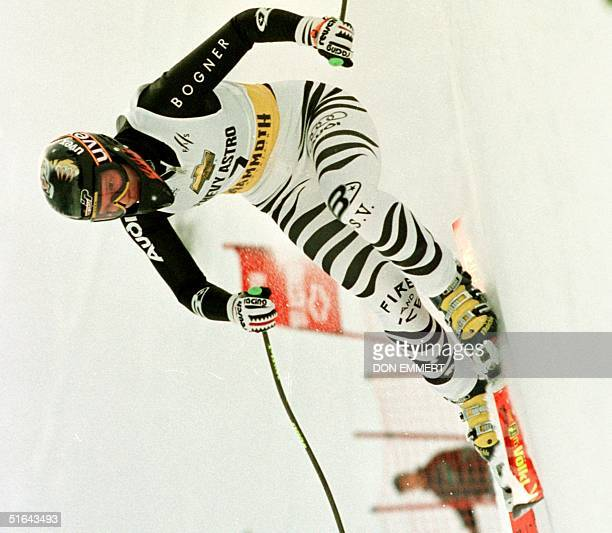 Katja Seizinger of Germany carves a turn 29 November during the women's World Cup Super G at Mammoth Mountain California Seizinger finished first...