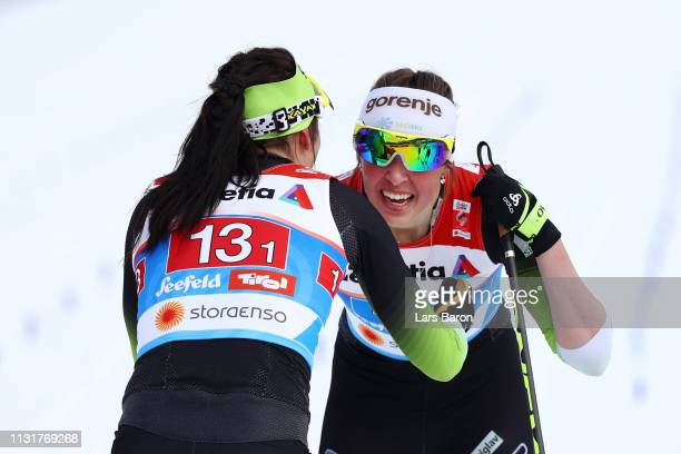 Katja Visnar of Slovenia and Anamarija Lampic of Slovenia celebrates after finishing second following the Ladies' Cross Country Team Sprint during...
