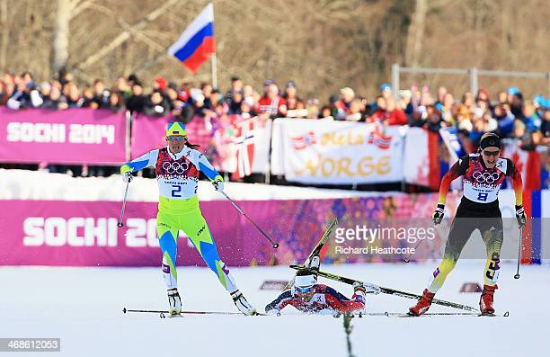 Katja Visnar of Slovenia and Denise Herrmann of Germany compete in the Finals of the Ladies' Sprint Free during day four of the Sochi 2014 Winter...