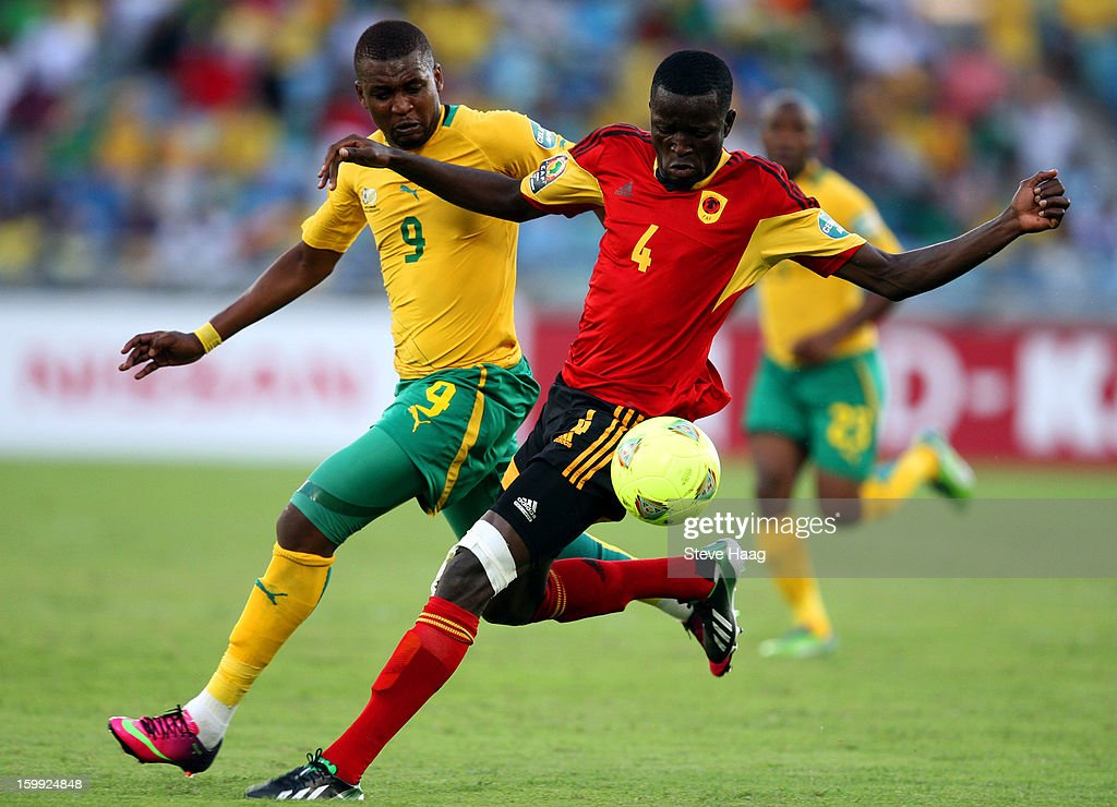 Katlego Mphela of South Africa in action against Dani Massunguna of Angola during the 2013 African Cup of Nations match between South Africa and Angola at Moses Mahbida Stadium on January 23, 2013 in Durban, South Africa.