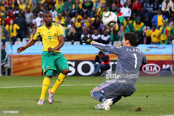 Katlego Mphela of South Africa shoots at goal during the 2010 FIFA World Cup South Africa Group A match between France and South Africa at the Free...