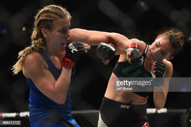 Katlyn Chookagian and Irene Aldana of Mexico exchange punches in their women's bantamweight bout during the UFC 210 event at the KeyBank Center on...